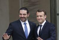 صورة تجمعه بالرئيس الفرنسي