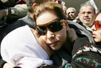 تعد مطلوبة من السلطات العراقية بوصفها أحد أركان النظام العراقي السابق وتم طلب تسليمها من الأردن إلى العراق دون أن تستجيب الأردن