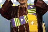 القذافي بالزي في إحدى المناسبات العالمية
