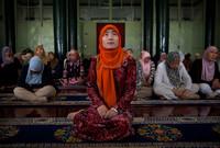 كما منعت ارتداء الحجاب أو النقاب للنساء ومن يخالف تلك القوانين فإنه يتعرض للسجن والتعذيب