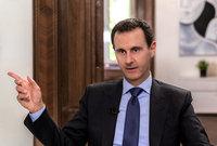 الابن الأوسط هو بشار الأسد والمولود عام 1965 وهو الرئيس التاسع عشر لسوريا والخامس في تاريخ الجمهورية العربية السورية وخلف والده في الحكم منذ عام 2000